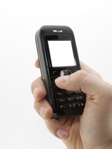 1307593_mobile_phone_in_hand.jpg